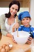 Mother and son preparing cookies - stock photo