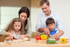 Family slicing ingredients - stock photo