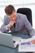 Stock Photo of Businessman looking at market research results