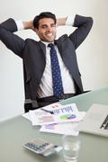 Portrait of a smiling sales person relaxing - stock photo