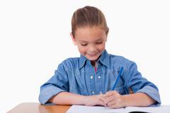 Stock Photo of Little girl writing