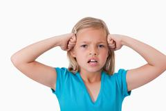Angry girl with the fists on her face - stock photo