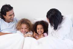 Family having fun on the bedroom Stock Photos