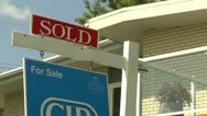 Stock Video Footage of real estate sold sign and house, average suburban home