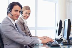 Good looking operators using a computer - stock photo