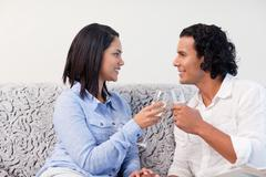 Stock Photo of Couple having sparkling wine on the couch