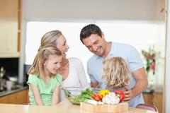 Stock Photo of Happy family in the kitchen