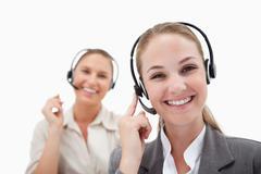 Joyful operators using headsets - stock photo