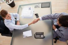 Above view of consultant shaking hands with customer Stock Photos