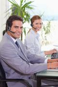 Side view of call center agents - stock photo
