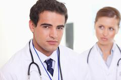 Assistant doctors standing next to each other - stock photo