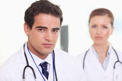 Medical assistants standing next to each other - stock photo