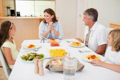 Stock Photo of Family sitting at the dinner table