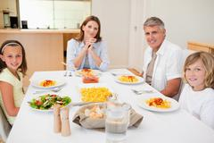 Stock Photo of Family about to have dinner