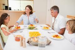Stock Photo of Family sitting for dinner