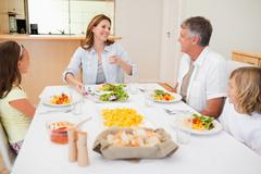 Stock Photo of Cheerful family at the dinner table