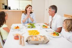 Stock Photo of Happy family at the dinner table