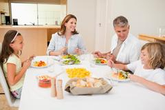 Stock Photo of Family having a conversation while dinner