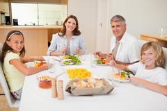 Stock Photo of Smiling family having dinner