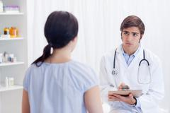 Physician talking with patient - stock photo