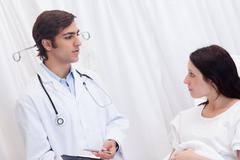Stock Photo of Patient getting examination results explained by doctor