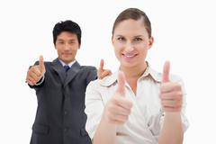 Business people with the thumbs up Stock Photos
