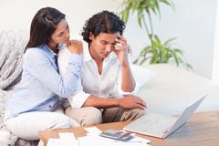 Frustrated couple underestimated their expenses Stock Photos