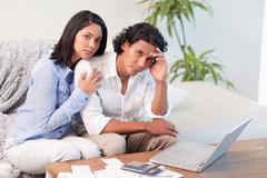Stock Photo of Frustrated couple underestimated their spending