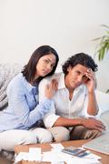 Couple frustrated over their financial situation - stock photo