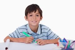Happy boy drawing - stock photo