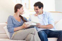 Man surprising his wife with a present - stock photo