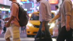 Crowd of people walking crossing street at night in New York slow motion 25P - stock footage
