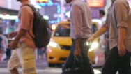 Stock Video Footage of Crowd of people walking crossing street at night in New York slow motion 25P