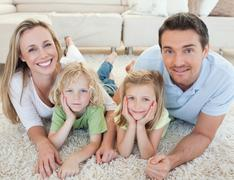 Stock Photo of Family lying on the carpet