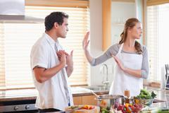 Couple arguing in the kitchen Stock Photos