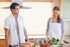 Couple having a tensed situation in the kitchen - stock photo