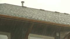 Weather, rain and hail falling on condo roof Stock Footage