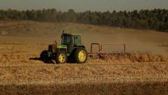 Tractor working  in the fild Stock Footage