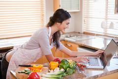 Stock Photo of Woman looking for a recipe on the internet