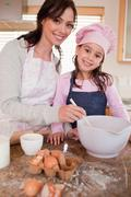 Stock Photo of Portrait of a happy mother baking with her daughter