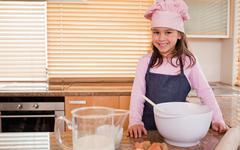 Stock Photo of Little girl baking