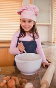 Stock Photo of Portrait of a girl baking