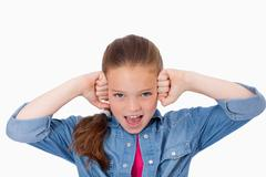 Girl with the fists on her face - stock photo