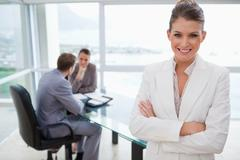 Smiling marketing manager standing in conference room - stock photo