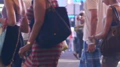 Crowd of people walking crossing street at night in New York City 60P Stock Footage