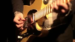 Picking guitar in slow motion - stock footage