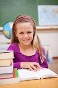 Portrait of young schoolgirl reading a book Stock Photos