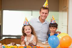 Stock Photo of Father celebrating birthday with his kids