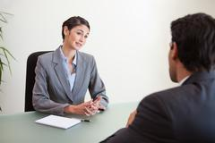 Manager interviewing a good looking applicant - stock photo