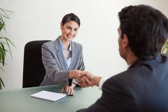 Manager shaking the hand of a customer - stock photo